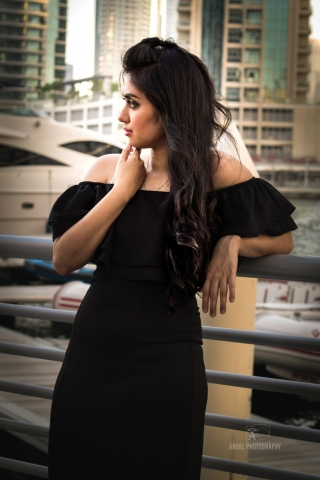 Fashion shoot, glam fashion shoot, Lady in black, curly long hair, angel bach artistry, makeup by angel bach, lady photographer, photographer in dubai, concept photo shoot, lady portraits, living room concept shoot